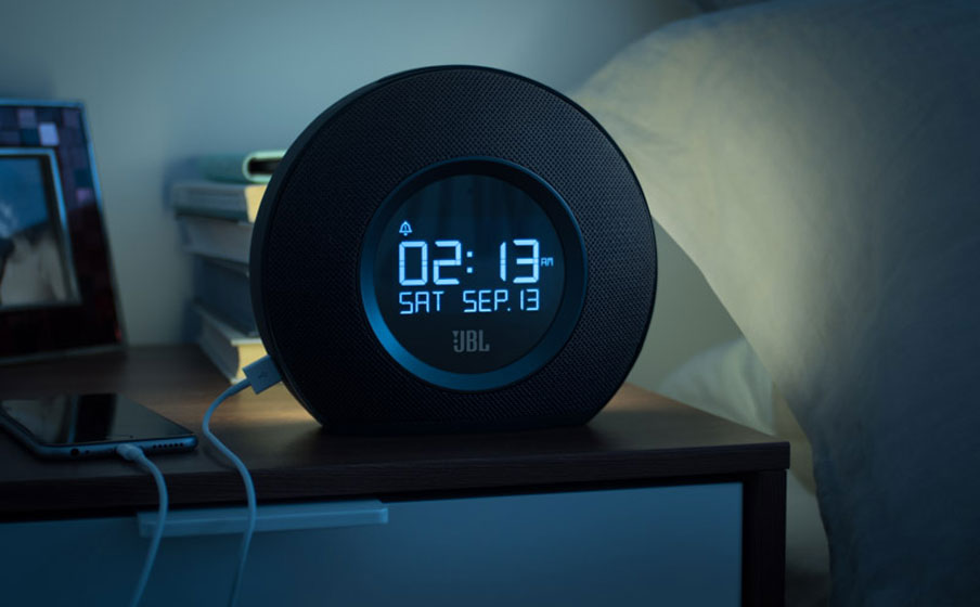 Multi-sensory alarm clock with LED ambient light